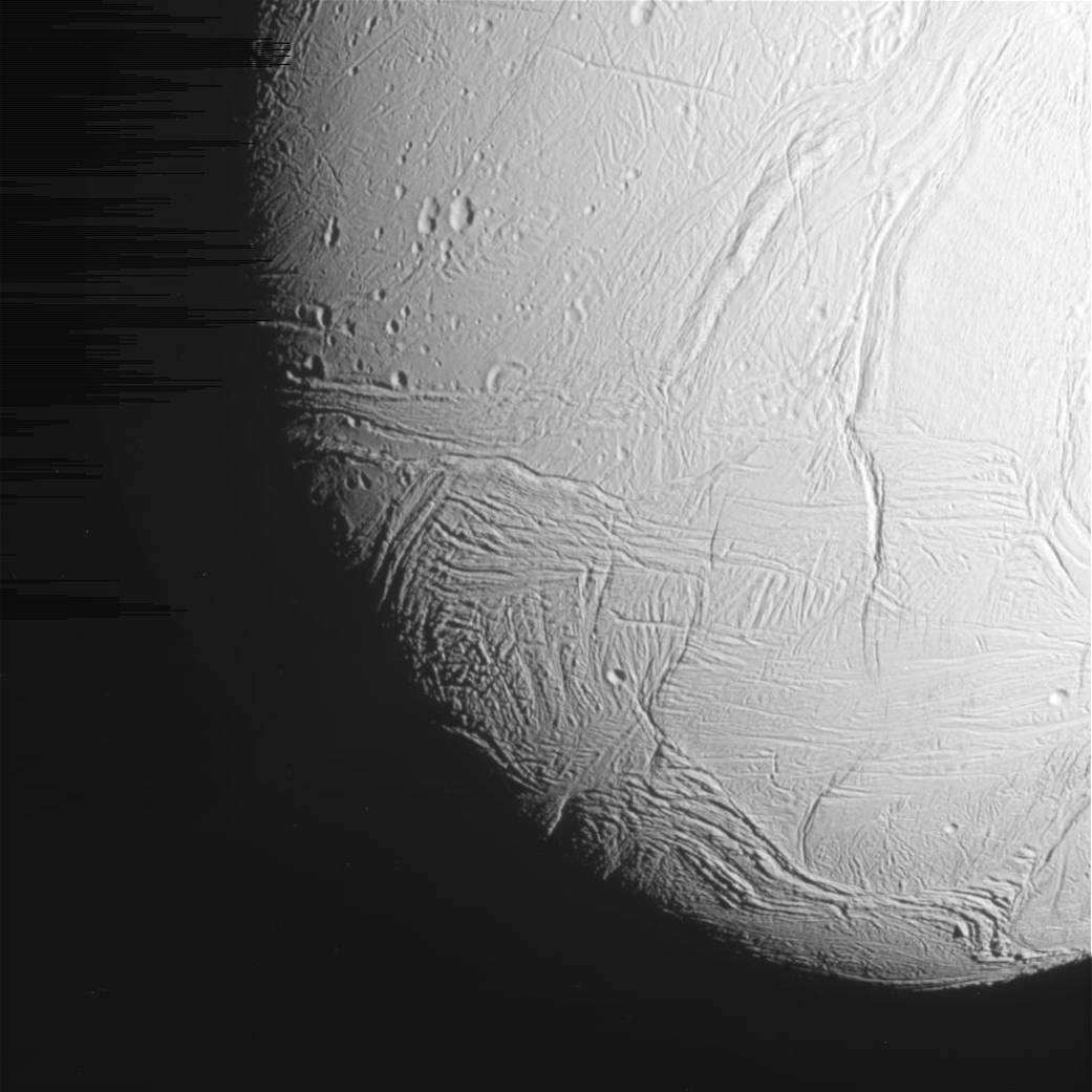 Closeup image of cratered surface of icy moon Enceladus