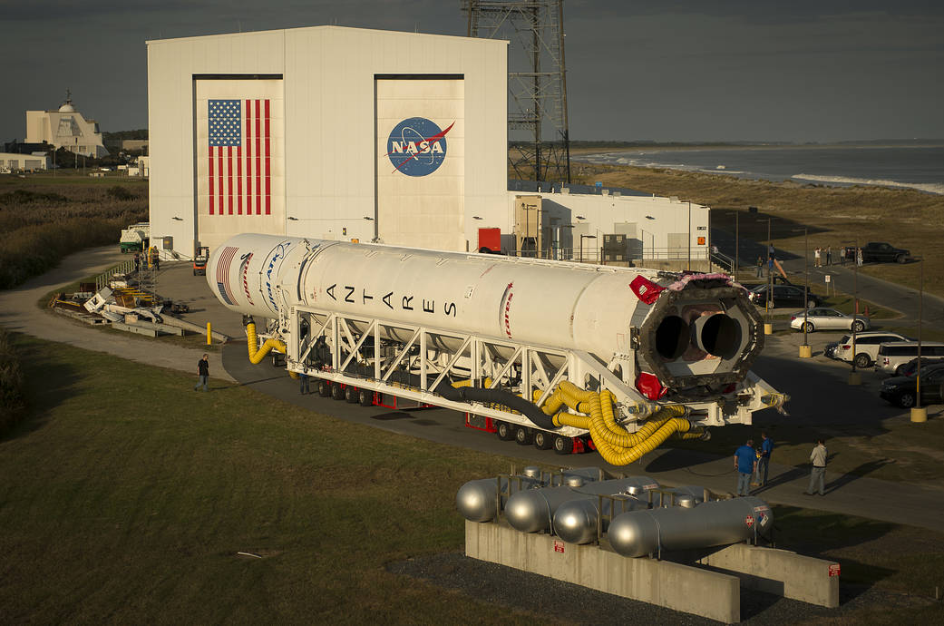 The Orbital ATK Antares rocket, with the Cygnus spacecraft onboard, is rolled out of the Horizontal Integration Facility (HIF) t