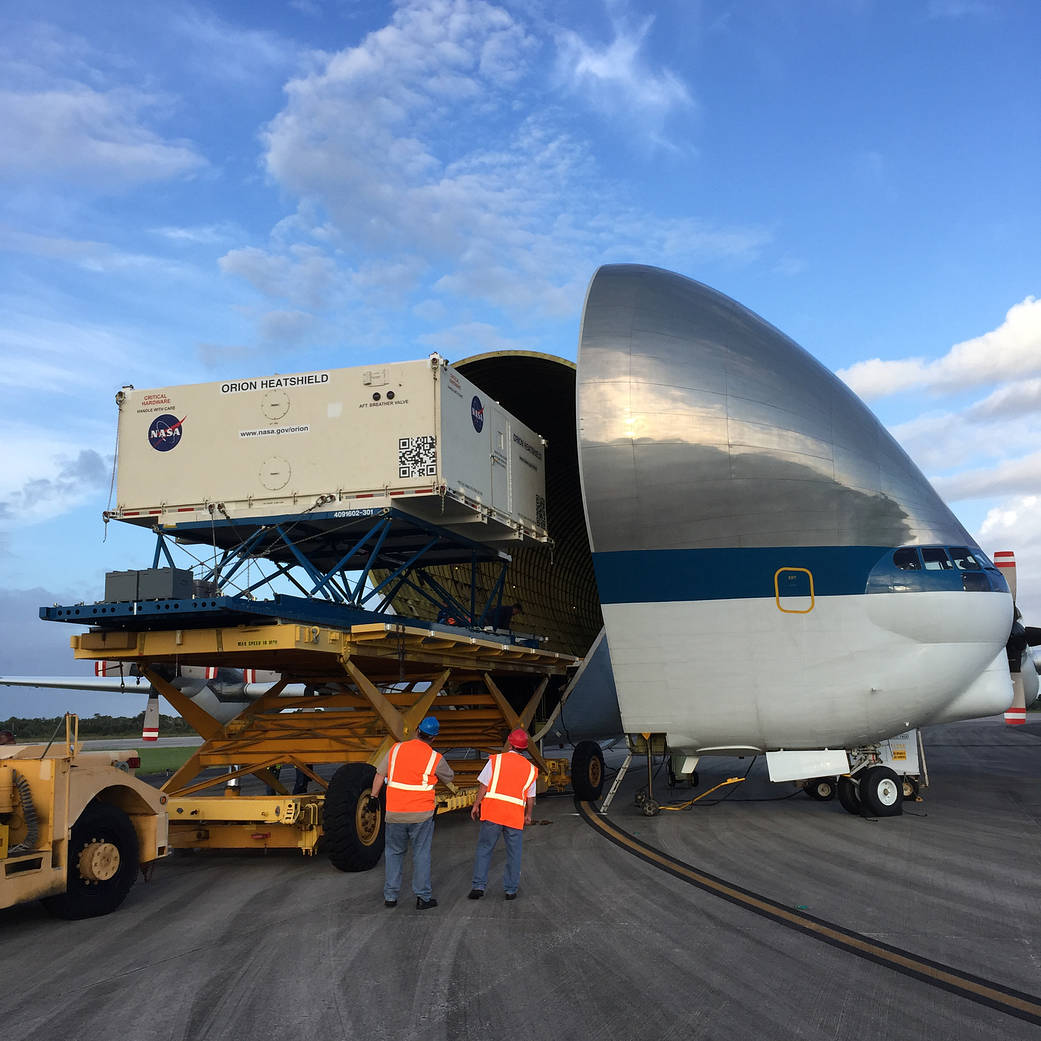 The Orion heat shield for Exploration Mission 1 arrives aboard the Super Guppy aircraft at Kennedy Space Center in Florida.