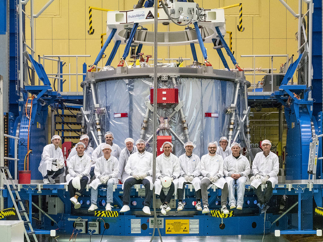 Airbus team poses with the European Service Module during preparations for shipment to KSC