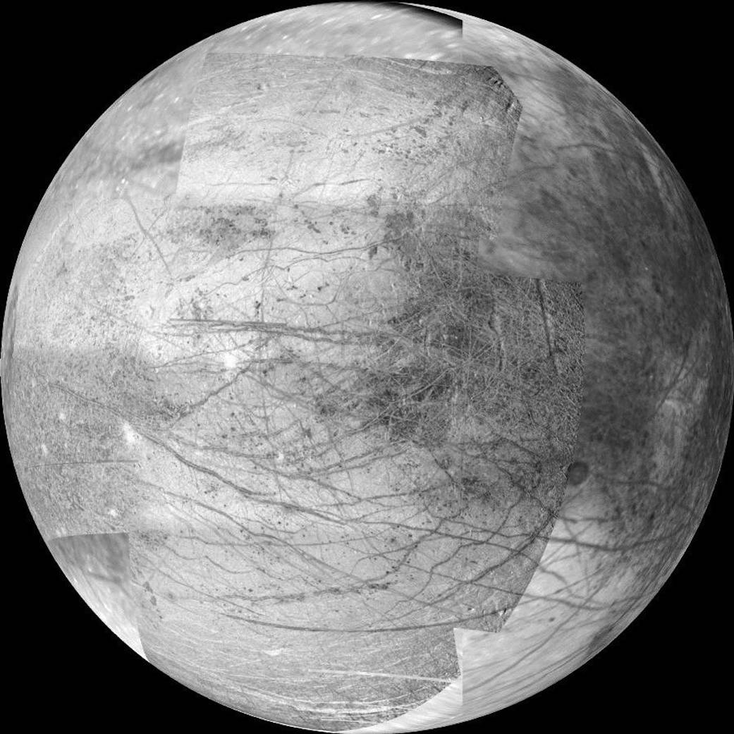 Closeup black and white mosaic image of moon Europa