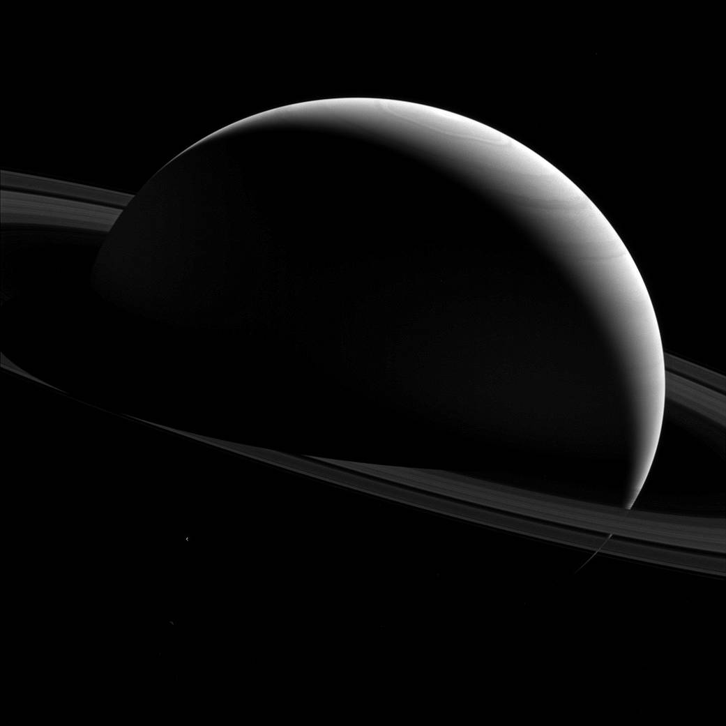 NASA picture of Saturn and the moon Tethys, taken by the Cassini probe