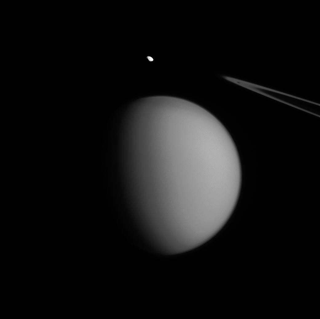 A coincidence of viewing angle makes Pandora appear to be hovering over Titan, almost like an accent mark.