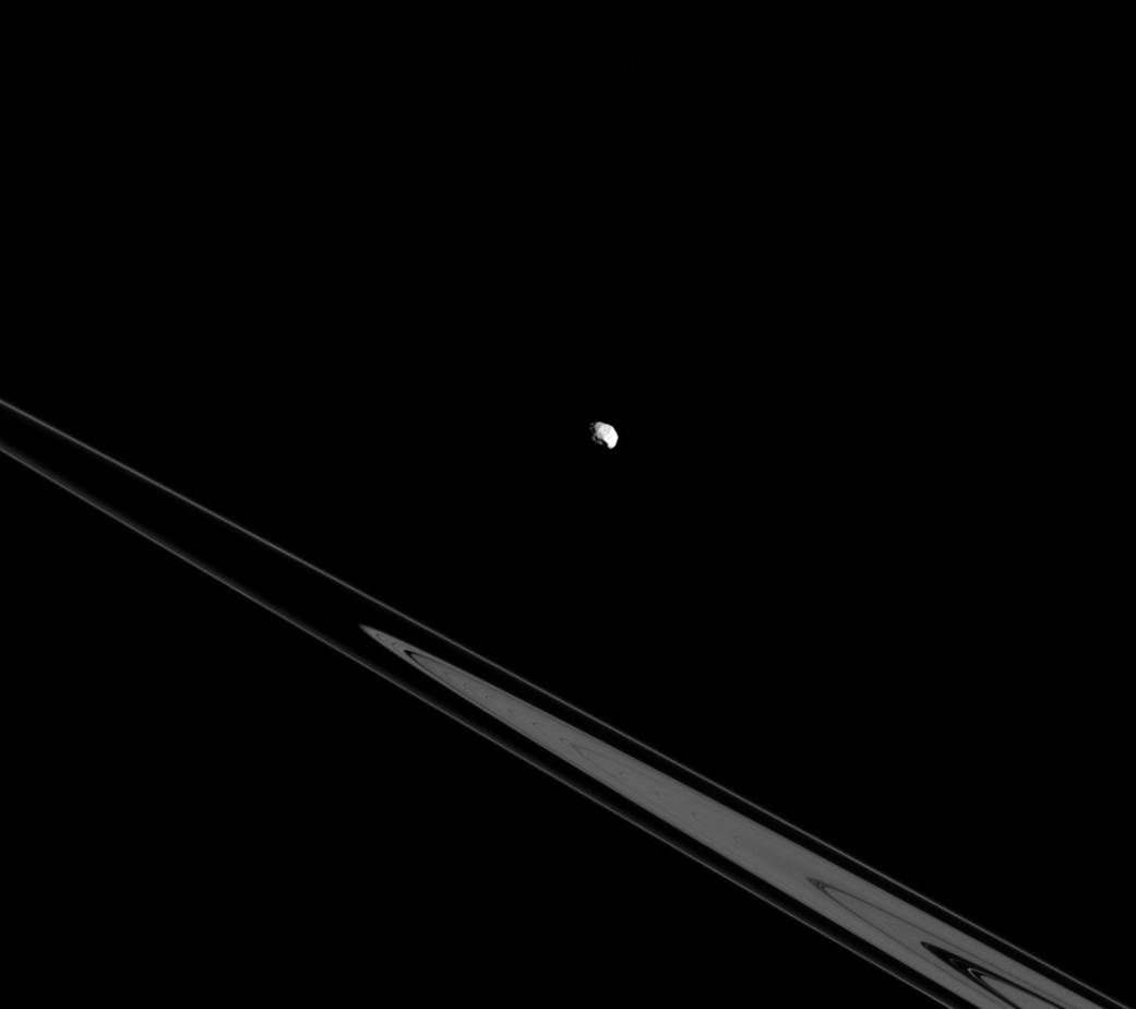 Epimetheus and the rings both orbit in Saturn's equatorial plane