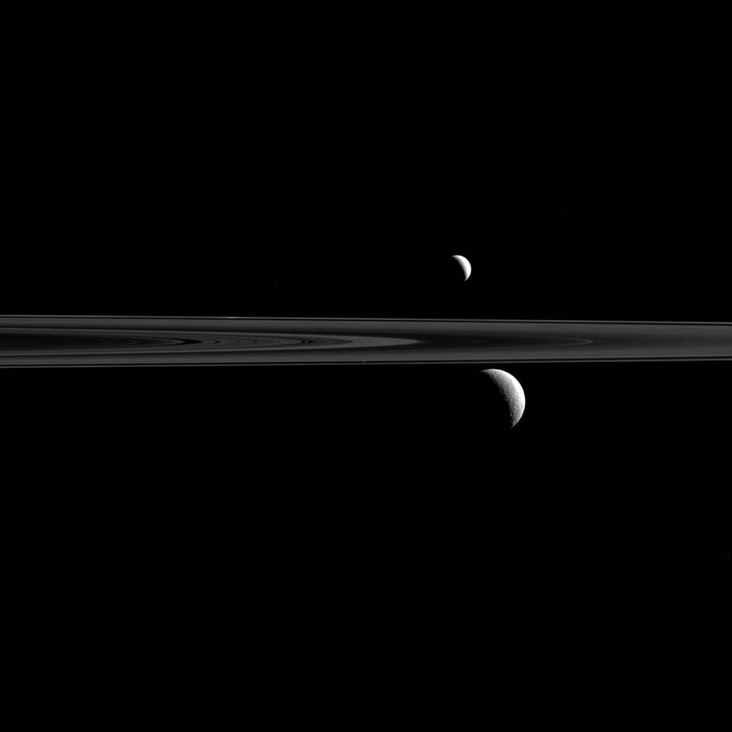 What looks like a pair of Saturnian satellites is actually a trio upon close inspection.