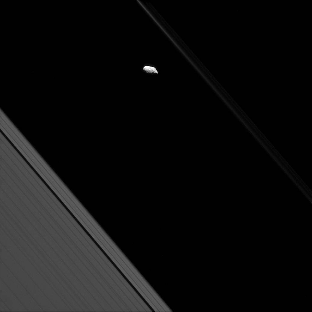Surface features are visible on Saturn's moon Prometheus in this view from NASA's Cassini spacecraft