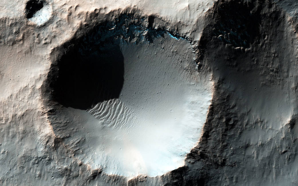Enhanced color HiRISE image shows several craters in the southern mid-latitudes of Mars