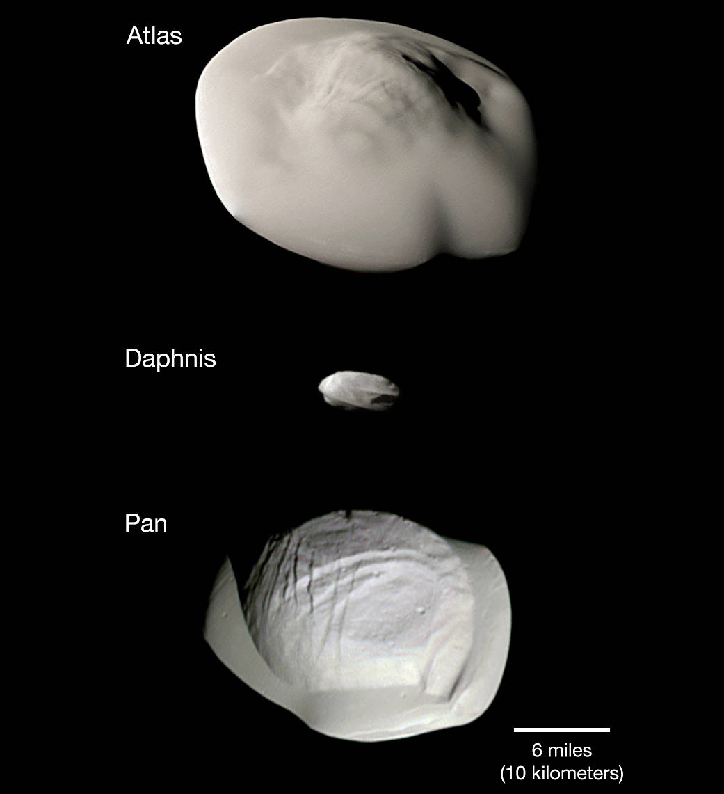 Montage of views from NASA's Cassini spacecraft shows three of Saturn's small ring moons: Atlas, Daphnis and Pan