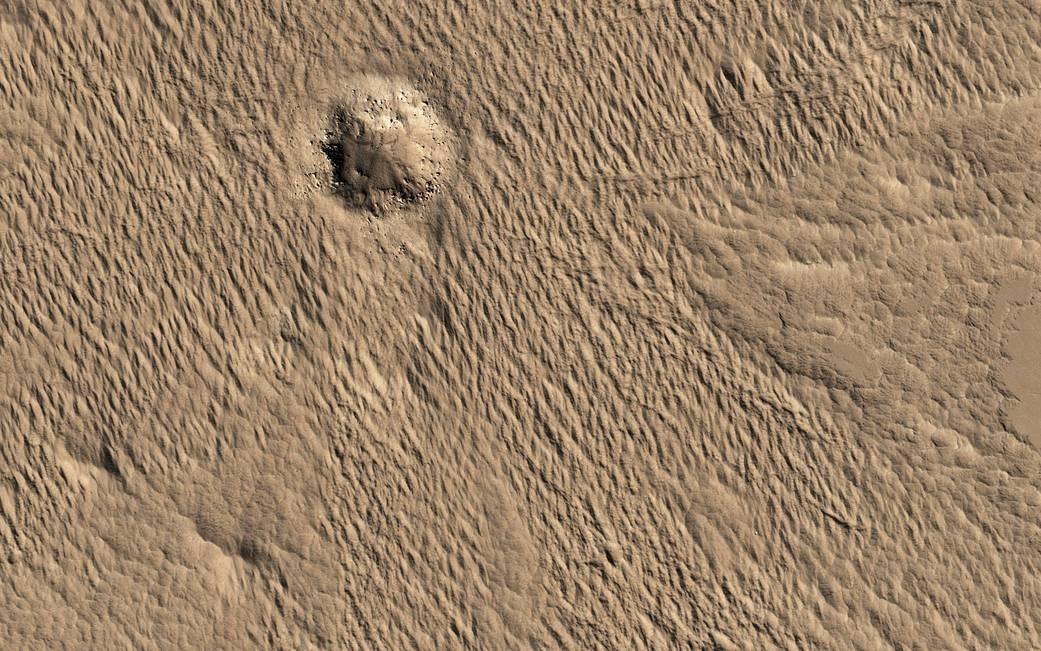 Impact crater near Amazonis Mensa and Medusae Fossae