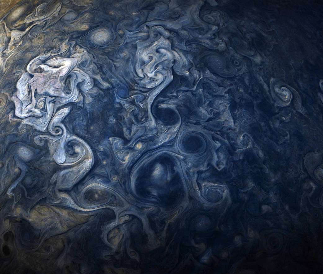 Jovian clouds in striking shades of blue, taken by NASA's Juno spacecraft