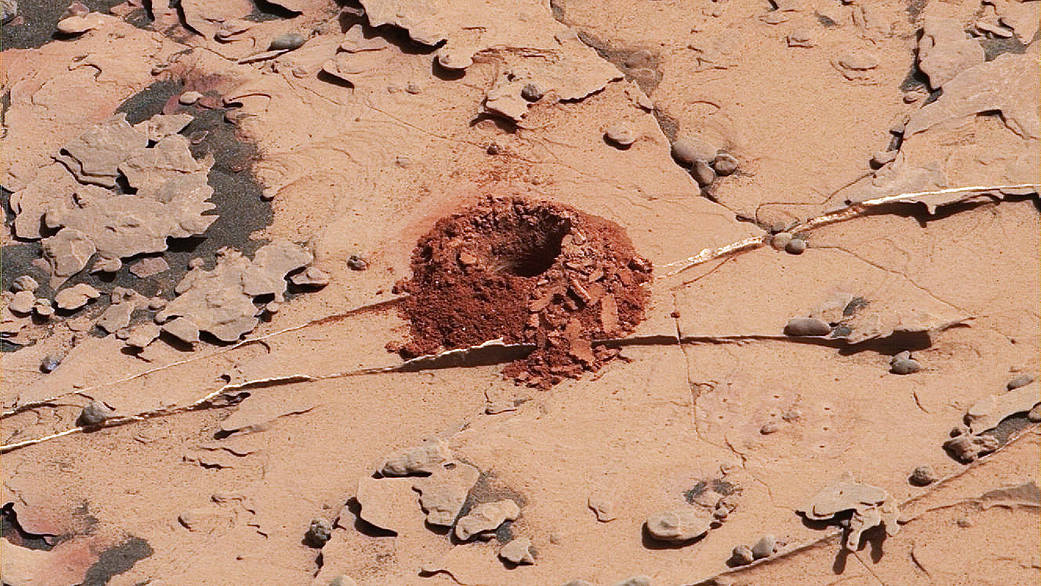 A close-up image of a 2-inch-deep hole produced using a new drilling technique for NASA's Curiosity rover