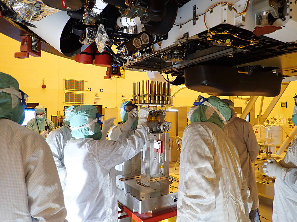 Engineers and technicians working on the Mars 2020 Perseverance team
