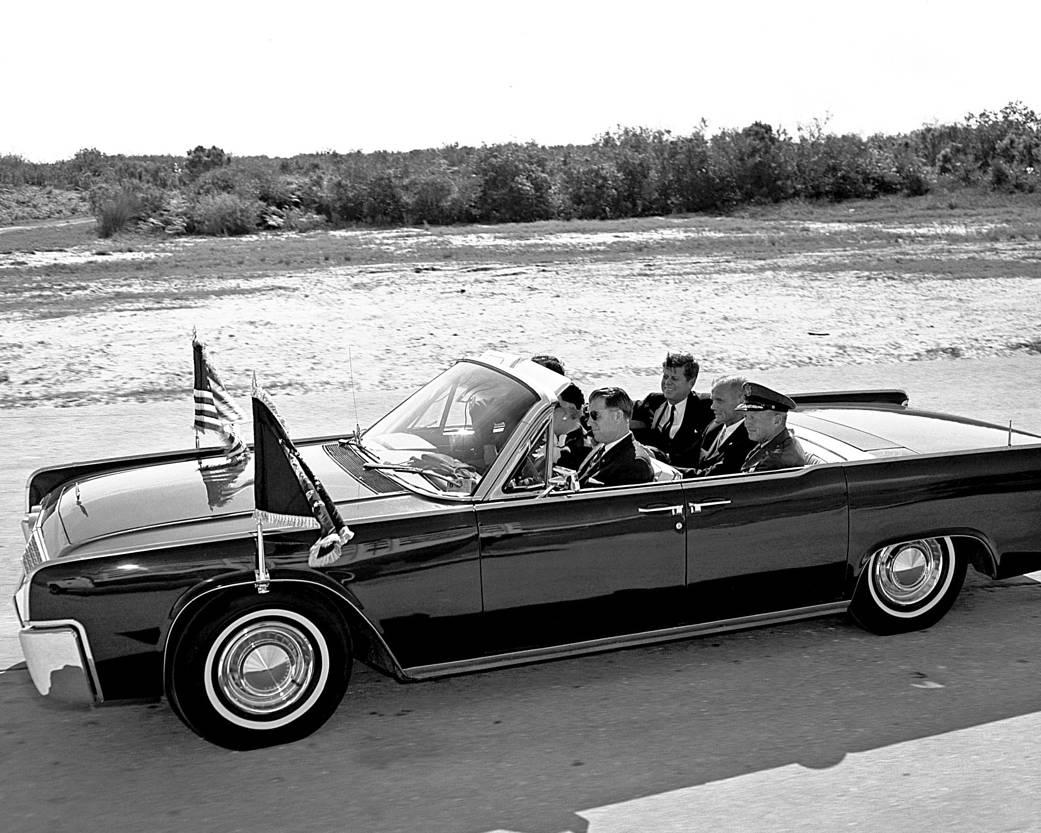 Astronaut John Glenn and President John F. Kennedy in convertible car