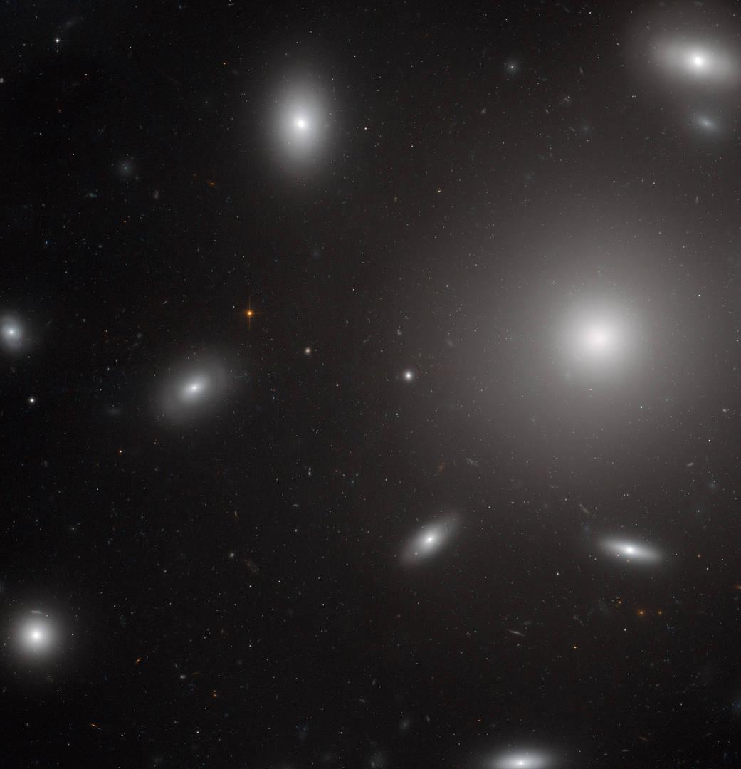 white blobs of stars around on big one