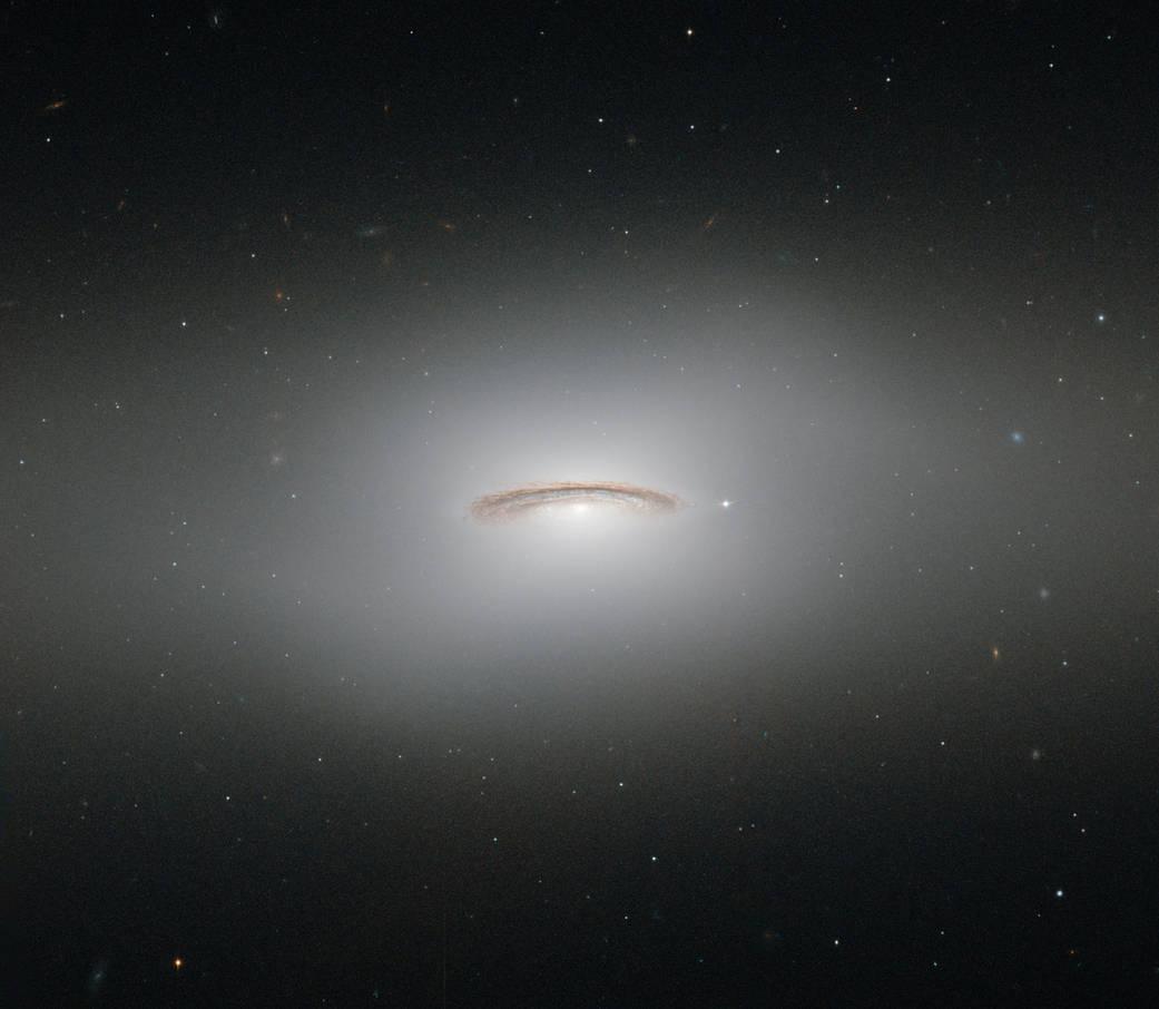 Bright lenticular galaxy in deep space