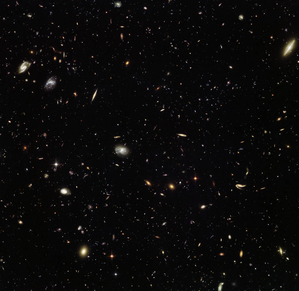 Hubble view of MACS J1149.5+2223, a galaxy cluster located approximately 5 billion light-years away