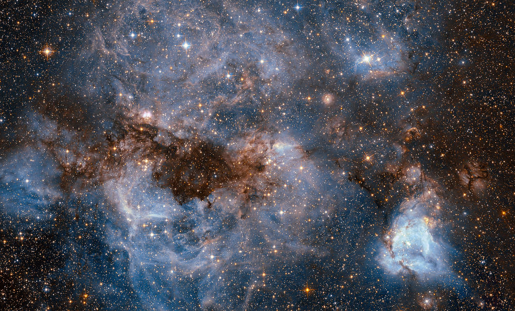 milky blue gasses, dark ruddy dust streaks and many stars