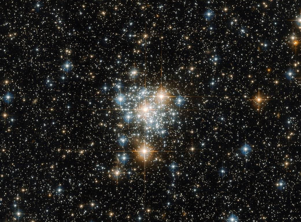 bright cluster of stars on a dark starfield