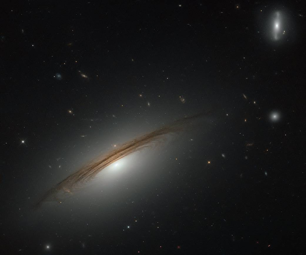 wispy dark spirals outline a galaxy