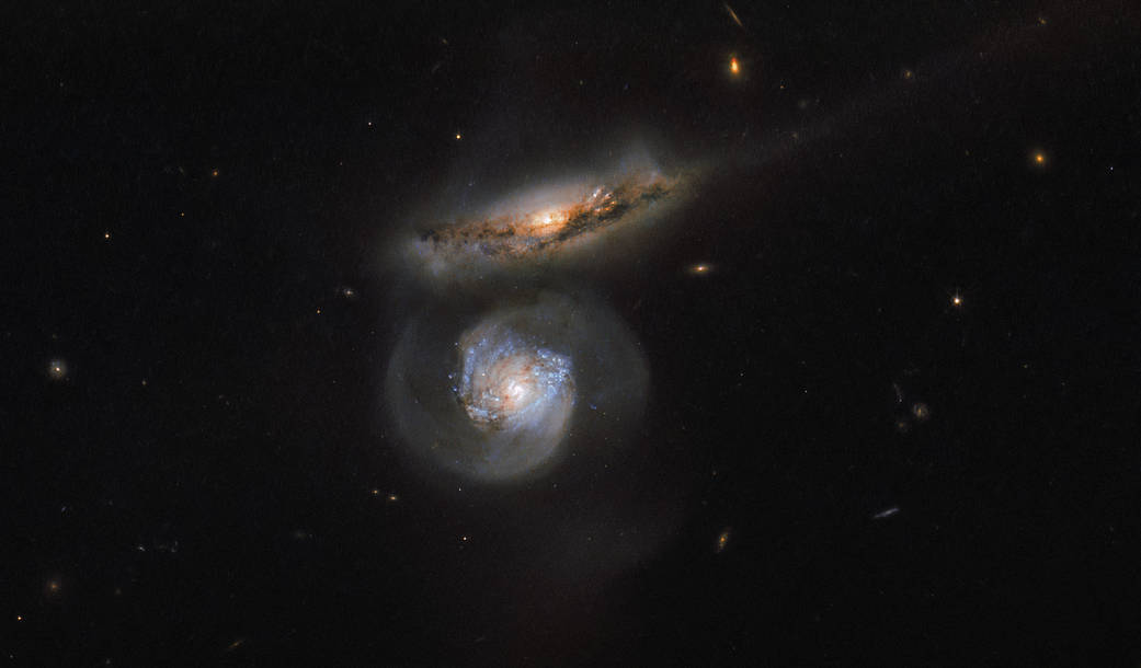 two galaxies, one head on and one edge on