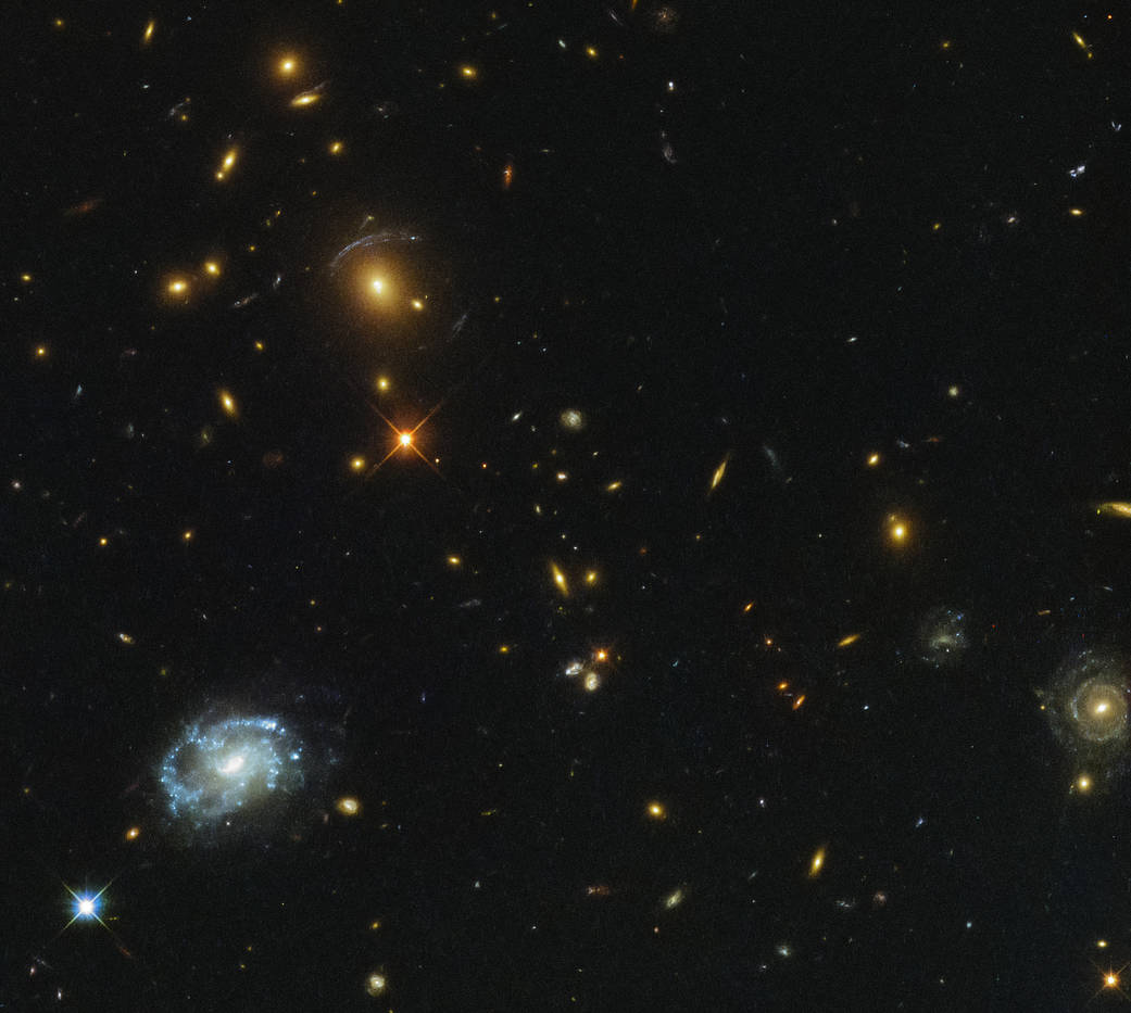 galaxies and stars sprinkled over a black field