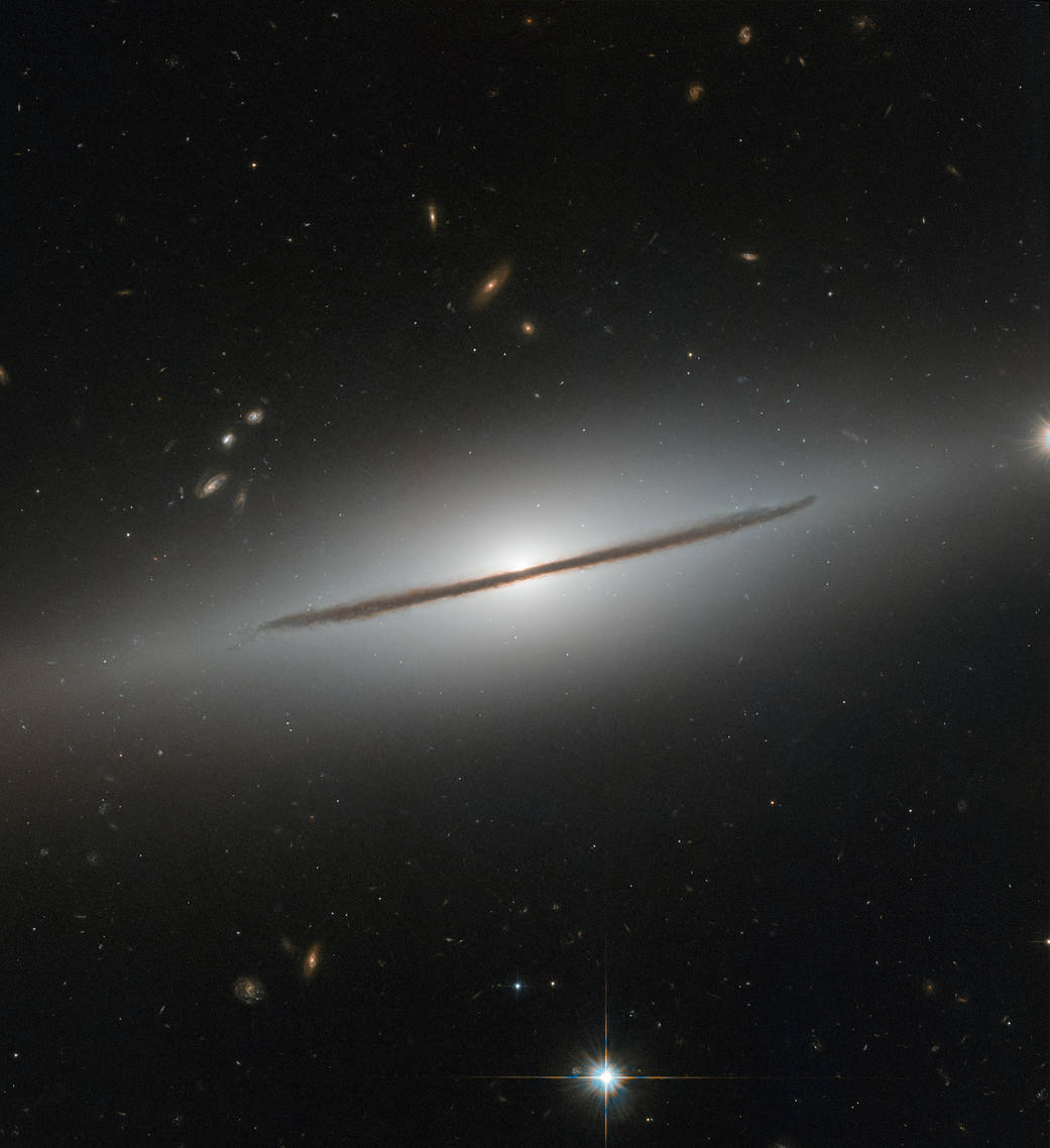 Bright white galaxy with a black bar along the centerline