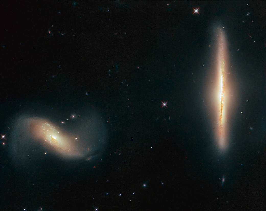 Hubble image of NGC 6285 (left) and NGC 6286 (right)