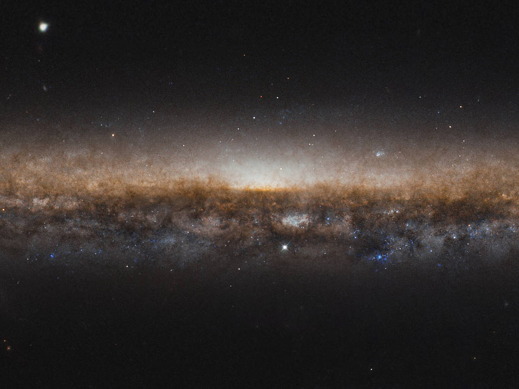 edge-on view of the stars in galaxy NGC 5907, bright against the backdrop of space