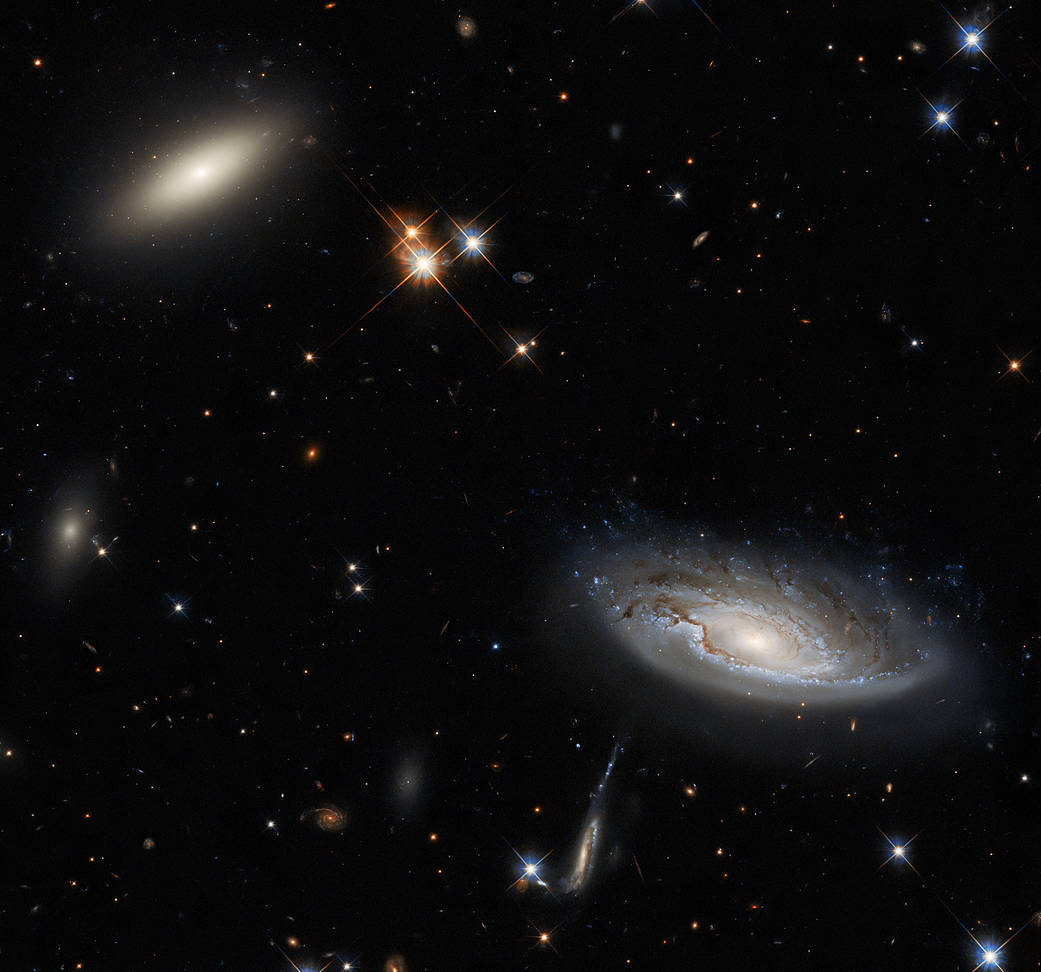 Two enormous galaxies capture your attention in this spectacular image taken with the NASA/ESA Hubble Space Telescope using the Wide Field Camera 3 (WFC3).