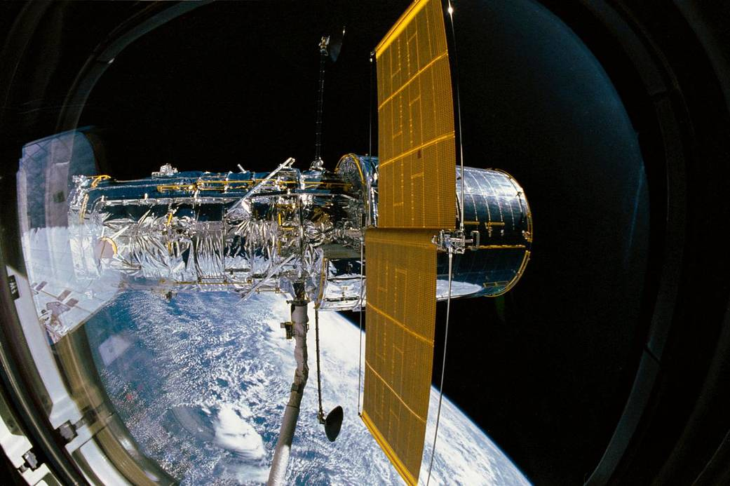 In 1990, the Hubble Space Telescope was deployed from the cargo bay of space shuttle Discovery.