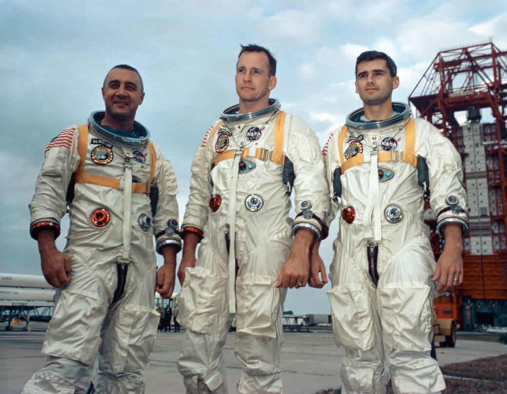 Apollo 1 prime crew in spacesuits pose for portrait during training outside in Florida