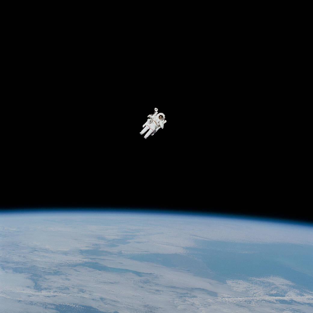 Spacewalking astronaut on untethered spacewalk surrounded ...