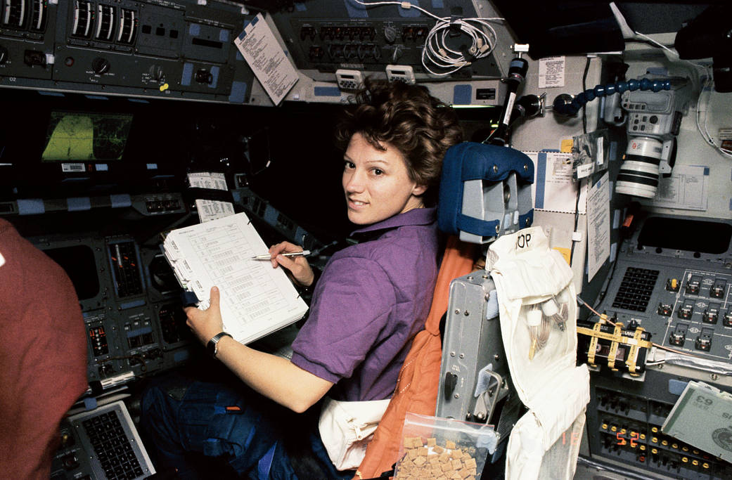 Astronaut Eileen Collins at pilot's station onboard shuttle Discovery