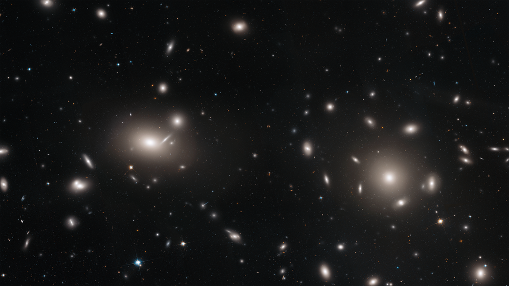 galaxies surrounded by tiny pinpoints of light