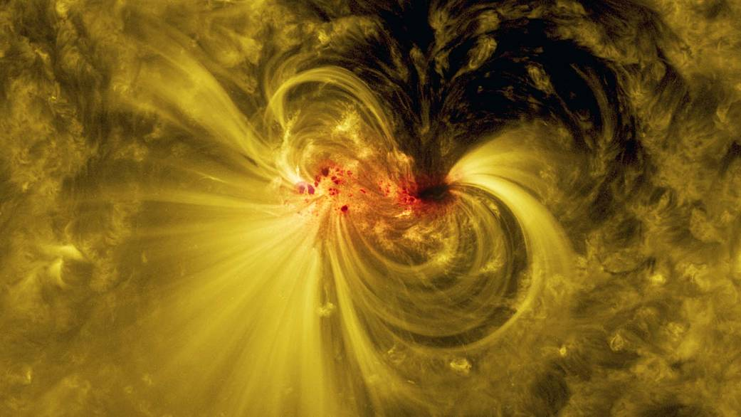 Closeup of sunspot showing coils arcing over active region