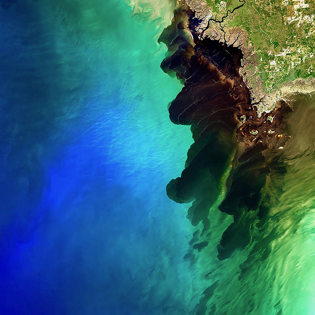 a large river discharge event, which resulted in a mesmerizing dark river plume contrasting with the deep blue color of the Gulf