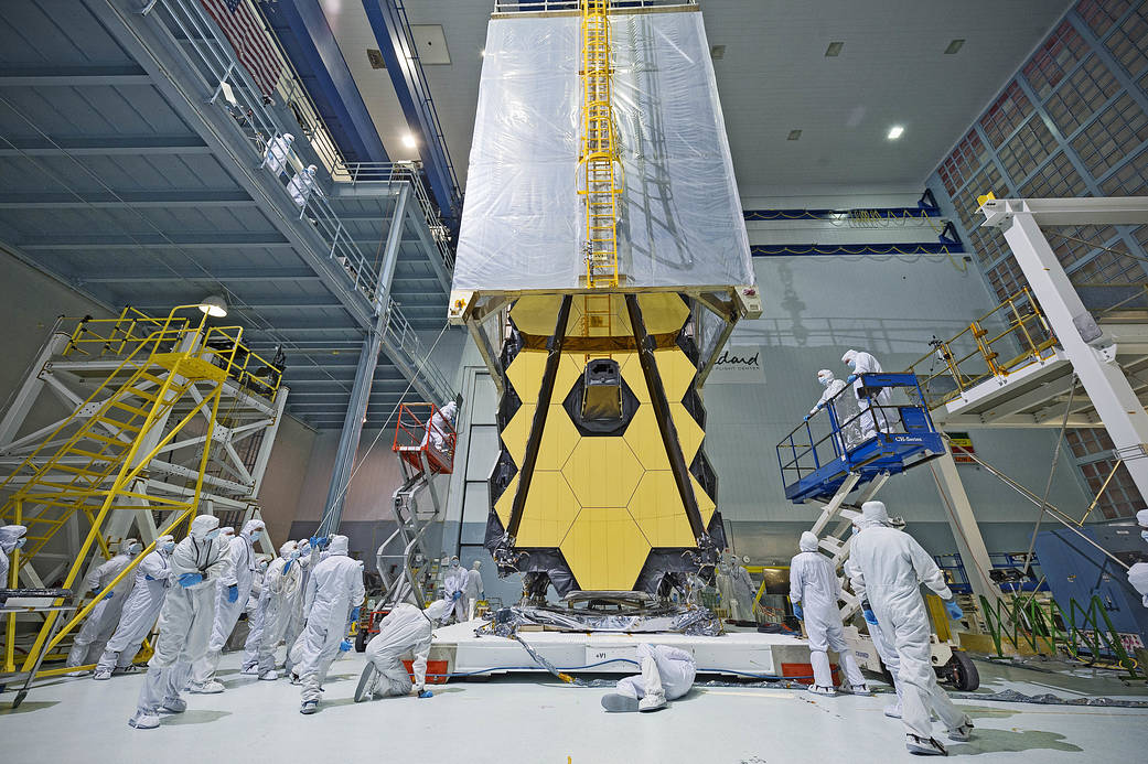Webb Telescope in clean room with tent being lowered over mirrors