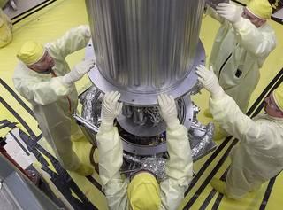 NASA & NNSA engineers lower the wall of the vacuum chamber around the Kilowatt Reactor Using Stirling TechnologY (KRUSTY system)