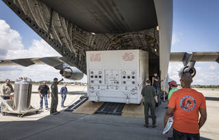 unloading of Parker Solar Probe shipping container from C-17