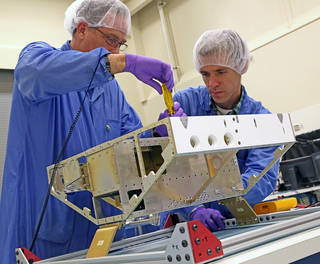 Engineers begin construction of the first of eight microsatellites for NASA's CYGNSS mission
