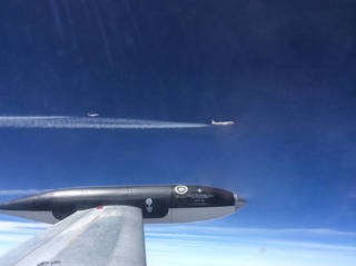 NASA's HU-25C Guardian aircraft flies 250 meters behind the agency's DC-8 aircraft