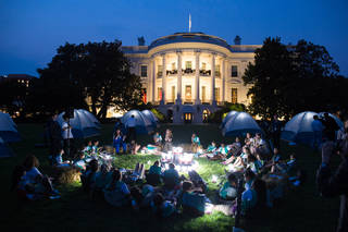 Girl Scout troop listens to astronaut Cady Coleman speak at evening event on White House lawn