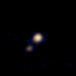 Low resolution image of Pluto and Charon in distance