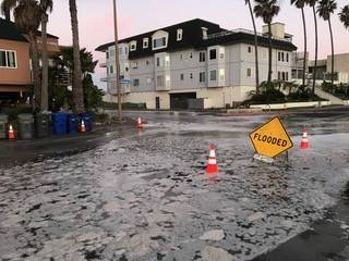 A flooded residential street in San Diego.