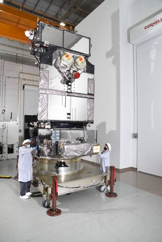 Northrop Grumman personnel examine the U.S. Space Force Space and Missile Systems Center's Space Test Program Satellite 6 at its facility in Dulles, Virginia, prior to its shipment to Florida for final launch processing.