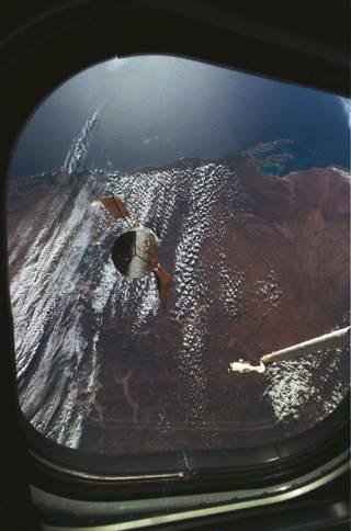 spacecraft over Earth seen through a window