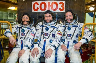 Expedition 59 crew members Christina Koch of NASA, Alexey Ovchinin of Roscosmos & Nick Hague of NASA during pre-launch training