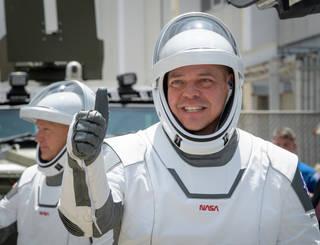 NASA astronauts Robert Behnken, foreground, and Douglas Hurley, wearing SpaceX spacesuits