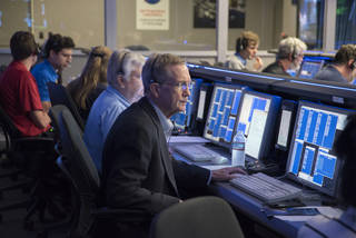 Cassini Team sits at controls and waits for image download