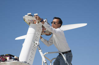Yohan Lin, Airvolt integration lead, prepares the electric propulsion test stand.